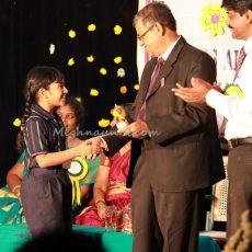 Receiving Prize from Mr. K. Kothandaraman, Sr. Principal, Velammal International School