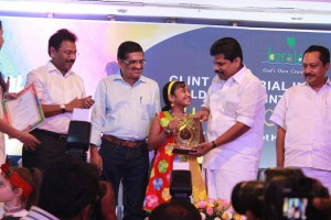 Receiving Clint Painting Competition Award from Kerala Tourism Minister